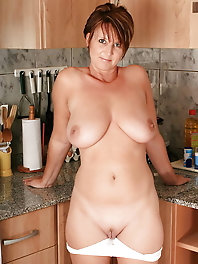 Elegant-looking milf is fingering herself