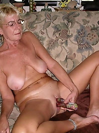 Smiling aged grannies put on sexy bra