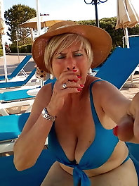 Hot-looking mature mom puts on sexy bra